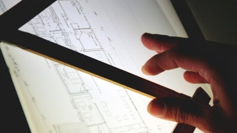 Arsitek sedang menggambar